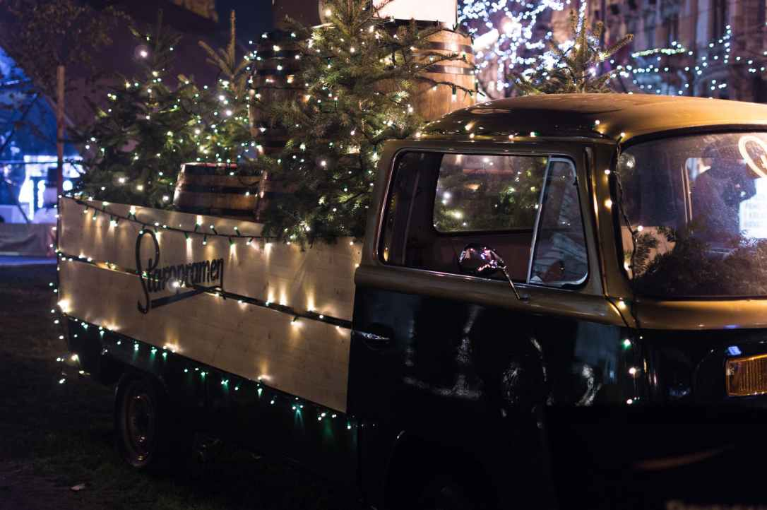 classic brown single cab truck with christmas tree