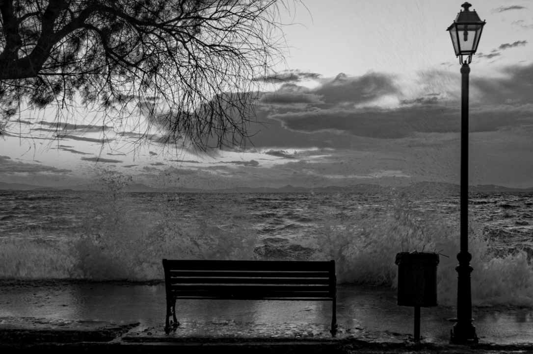 bench black and white storm waves
